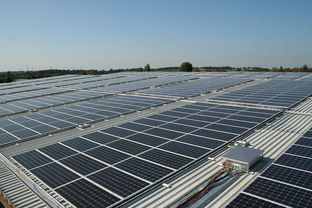 Solar panels turn a warehouse roof into an energy asset.