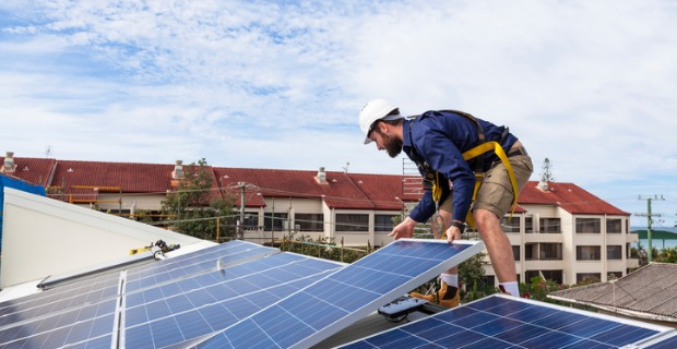 Installing solar is one way of creating energy efficient community housing.