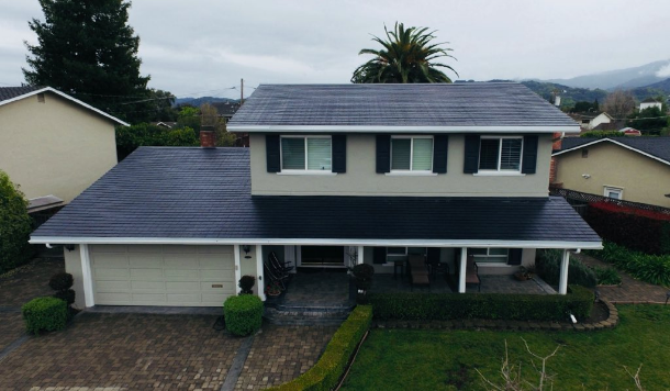 Tesla's new Solar Roof comes with a lifetime guarantee and can be combined with Powerwall batteries for self-sufficiency.