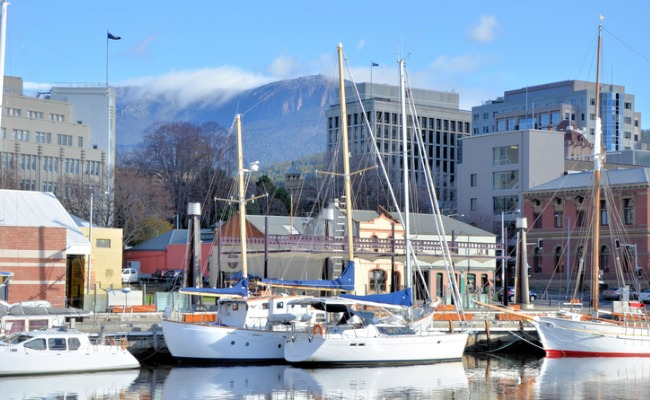 Hobart nestles under the often snow-peaked Mt Wellington.