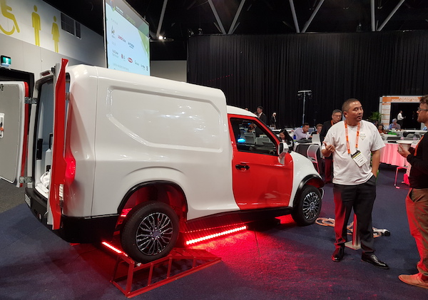 ACE Cargo EV with designer Will Qiang talking to an attendee at SEC 2019.